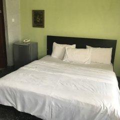 Отель Pentagon Luxury Suites Enugu Энугу комната для гостей фото 2