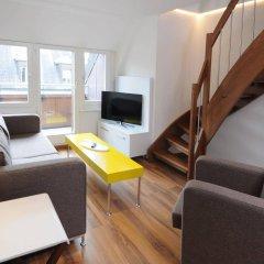 Апартаменты Luxury Apartments by Livingdowntown комната для гостей фото 4