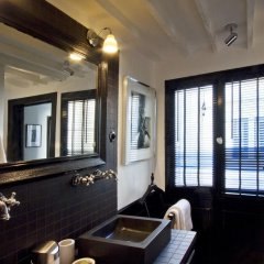 Отель Les Suites Parisiennes Франция, Париж - отзывы, цены и фото номеров - забронировать отель Les Suites Parisiennes онлайн гостиничный бар