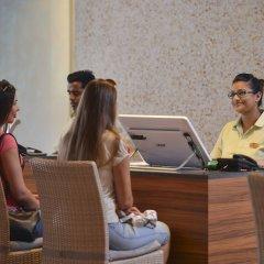 Отель Bandos Maldives Мальдивы, Бандос Айленд - 12 отзывов об отеле, цены и фото номеров - забронировать отель Bandos Maldives онлайн интерьер отеля