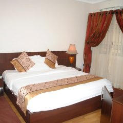 Отель Grand Inn & Suites комната для гостей фото 4