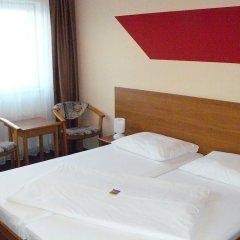 astral Inn Hotel Leipzig Лейпциг комната для гостей фото 5