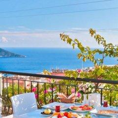 Samira Exclusive Hotel & Apartments Турция, Калкан - отзывы, цены и фото номеров - забронировать отель Samira Exclusive Hotel & Apartments онлайн питание