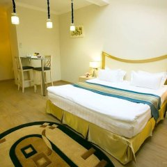 Metro Hotel Apartments Одесса комната для гостей фото 5