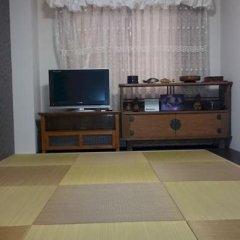 Отель Hikari House Токио в номере фото 2