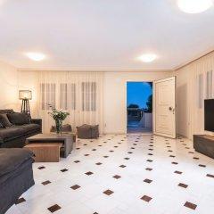 Отель Damma Beachfront Luxury Villa Греция, Остров Санторини - отзывы, цены и фото номеров - забронировать отель Damma Beachfront Luxury Villa онлайн комната для гостей фото 4