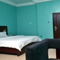 Отель Petesville Hotel Calabar Нигерия, Калабар - отзывы, цены и фото номеров - забронировать отель Petesville Hotel Calabar онлайн комната для гостей