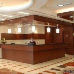 Отель Tulip Inn Sharjah Hotel Apartments ОАЭ, Шарджа - отзывы, цены и фото номеров - забронировать отель Tulip Inn Sharjah Hotel Apartments онлайн интерьер отеля