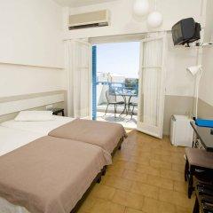 Kamari Beach Hotel комната для гостей фото 2