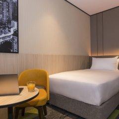 Отель Aerotel Guangzhou (In International Departure Hall Airside, after immi комната для гостей