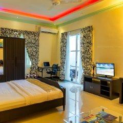 Отель Charming Holiday Lodge Мальдивы, Хулхудху (Атолл Адду) - отзывы, цены и фото номеров - забронировать отель Charming Holiday Lodge онлайн Хулхудху (Атолл Адду) комната для гостей фото 2