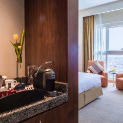 Отель Grand Millennium Al Wahda удобства в номере фото 2