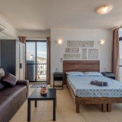Отель Seashells Studio Seaview terrace Мальта, Буджибба - отзывы, цены и фото номеров - забронировать отель Seashells Studio Seaview terrace онлайн комната для гостей