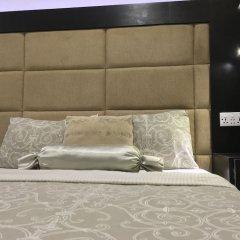 Отель Millennium Apartments Нигерия, Лагос - отзывы, цены и фото номеров - забронировать отель Millennium Apartments онлайн комната для гостей фото 3