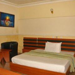 Отель Xcape Hotels and Suites Ltd Нигерия, Калабар - отзывы, цены и фото номеров - забронировать отель Xcape Hotels and Suites Ltd онлайн комната для гостей фото 2