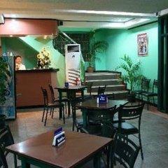 Отель Ardent Suites Hotel & Spa Inc Филиппины, Пуэрто-Принцеса - отзывы, цены и фото номеров - забронировать отель Ardent Suites Hotel & Spa Inc онлайн питание