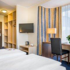 Отель Novum Hotel Mariella Airport Германия, Кёльн - 1 отзыв об отеле, цены и фото номеров - забронировать отель Novum Hotel Mariella Airport онлайн удобства в номере фото 2