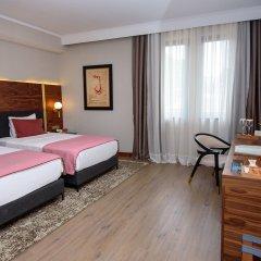 Отель Tiflis Palace комната для гостей фото 9