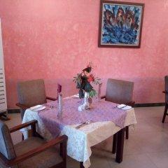 Отель Axari Hotel & Suites Нигерия, Калабар - отзывы, цены и фото номеров - забронировать отель Axari Hotel & Suites онлайн питание фото 2