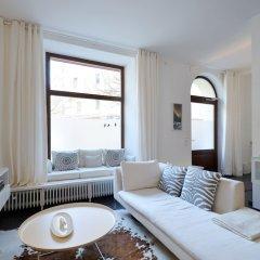 Апартаменты Cocoma-Design-Apartment Мюнхен комната для гостей фото 5