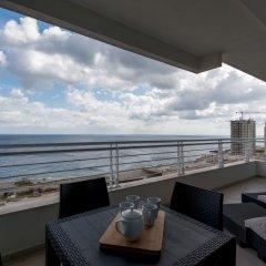 Отель Seafront Apart IN Fort Cambridge Мальта, Слима - отзывы, цены и фото номеров - забронировать отель Seafront Apart IN Fort Cambridge онлайн балкон
