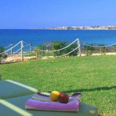 Отель Blue Coral Beach Villas спортивное сооружение
