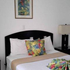 Отель Hibiscus Lodge Ямайка, Очо-Риос - отзывы, цены и фото номеров - забронировать отель Hibiscus Lodge онлайн комната для гостей