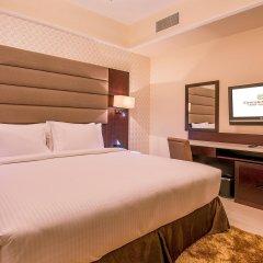 Emirates Grand Hotel Apartments Дубай комната для гостей
