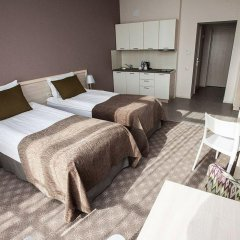 Гостиница Спорт Инн комната для гостей
