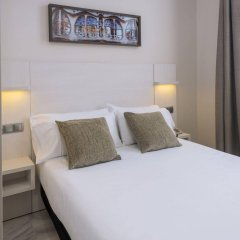 Отель SERHS Carlit Испания, Барселона - 4 отзыва об отеле, цены и фото номеров - забронировать отель SERHS Carlit онлайн комната для гостей фото 3