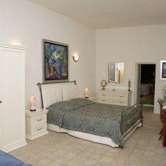 Отель Adamis Majesty Suites Греция, Остров Санторини - отзывы, цены и фото номеров - забронировать отель Adamis Majesty Suites онлайн комната для гостей