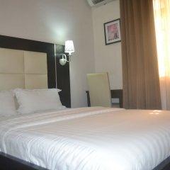 Отель Mac Dove Lounge & Suites ltd комната для гостей фото 3