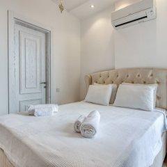 Villa Palmiye by Akdenizvillam Турция, Калкан - отзывы, цены и фото номеров - забронировать отель Villa Palmiye by Akdenizvillam онлайн комната для гостей фото 5