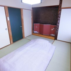 Отель Toji Stay HIROMIYA Беппу комната для гостей