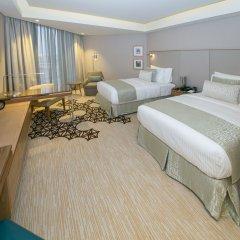 Отель Grand Millennium Muscat комната для гостей фото 3