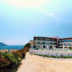 Rhapsody Hotel & Spa Kalkan Турция, Калкан - отзывы, цены и фото номеров - забронировать отель Rhapsody Hotel & Spa Kalkan онлайн пляж