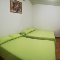 Отель BM Zihua Casa de Huéspedes комната для гостей фото 5