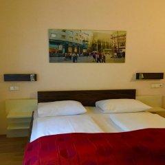 Отель City Rooms сейф в номере