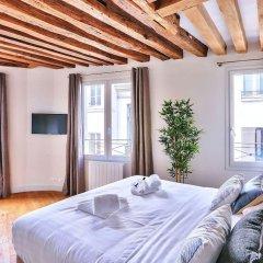 Апартаменты Amazing Apartment Close to Notre Dame Париж комната для гостей фото 4