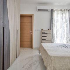 Отель First Class Apartments Calleja by G&G Мальта, Буджибба - отзывы, цены и фото номеров - забронировать отель First Class Apartments Calleja by G&G онлайн комната для гостей фото 2