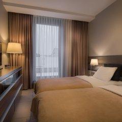 Отель Elite Apartments Galileo Польша, Познань - отзывы, цены и фото номеров - забронировать отель Elite Apartments Galileo онлайн комната для гостей фото 5