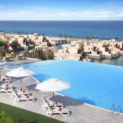 Отель The Cove Rotana Resort бассейн фото 5
