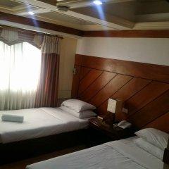 Отель Wregent Plaza Hotel Филиппины, Тагбиларан - отзывы, цены и фото номеров - забронировать отель Wregent Plaza Hotel онлайн комната для гостей фото 2