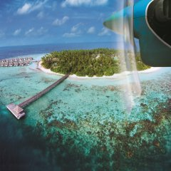 Отель Outrigger Konotta Maldives Resort пляж