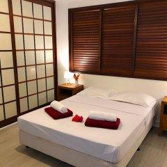 Отель Villa Riviera - Tahiti Французская Полинезия, Пунаауиа - отзывы, цены и фото номеров - забронировать отель Villa Riviera - Tahiti онлайн комната для гостей