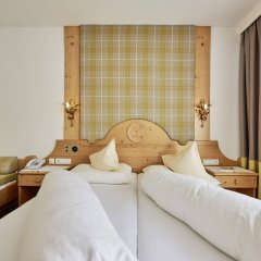 Отель Alpenhotel Laurin Австрия, Хохгургль - отзывы, цены и фото номеров - забронировать отель Alpenhotel Laurin онлайн комната для гостей фото 4