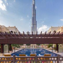 Отель Maison Privee - Burj Khalifa Community Дубай городской автобус