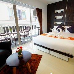 Апартаменты Sunset Apartments Паттайя комната для гостей