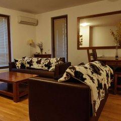 Апартаменты Predela 2 Holiday Apartments Банско комната для гостей фото 2