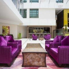 Traders Hotel Qaryat Al Beri Abu Dhabi, by Shangri-la интерьер отеля фото 3